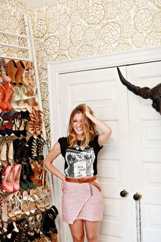 Perfect closet full of shoes and fun wallpaper!