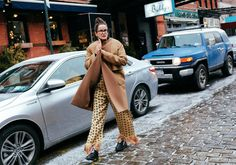 Lucy Chadwick in a Céline coat and Edun jumpsuit