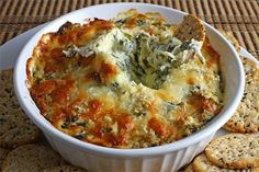 Hot Spinach  Artichoke Dip. Spinach, artichoke hearts, cream cheese, sour cream, mayonnaise, garlic, parmesan cheese, and mozzarella cheese. Yum! Im always looking for new spinach  artichoke dips. food