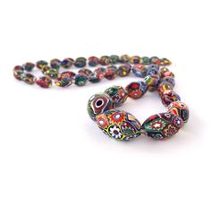 A personal favorite from my Etsy shop https://www.etsy.com/listing/229818628/vintage-millefiori-bead-necklace