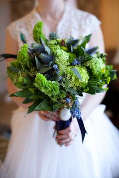 blues and greens:  bells, hydrangea, muscari, thistle, and more.  Beautiful bouquet, but I'd use it as a centerpiece.
