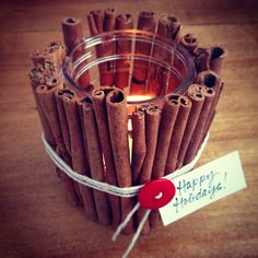 cinnamon sticks around a candle holder