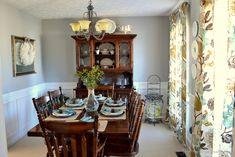 Dining room with white wainscoting - house tour at TheFrugalHomemaker.com