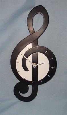 Treble Clef Wall Clock (36cm). The ideal gift for music l... https://www.amazon.ca/dp/B00BYI20M8/ref=cm_sw_r_pi_dp_x_.RNJybG7J21T6