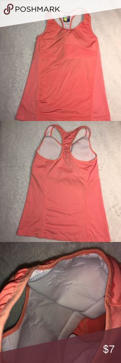🔥Sale! Racerback workout tank Great condition! Light orange color size M. Has built in padded bra and partial mesh lining. 10% spandex. Tops Tank Tops