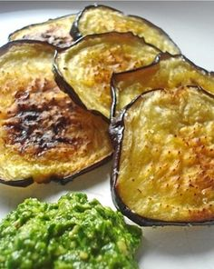 Baked Eggplant Chips with pesto.Baked Eggplant Chips eggplants, preferably Japanese variety olive oil sea salt Pesto (pictured above): 2 cups fresh spinach 1 cup fresh cilantro cup cashews cloves garlic olive oil