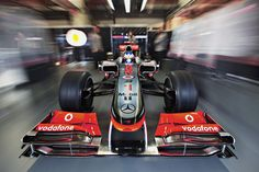Photograph of Jenson Button leaving the pit garage- Patrick Gosling photography