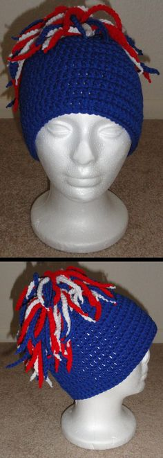 Team dreadlock hat - Make a hat using your favorite crochet beanie pattern (I used double crochets) then create several chain rows (ch 30-40, finish off (make enough to tie into the stitches of the first 3 rounds of your hat)). Once you have the chain rows, pull the tails really tight so when you cut them off, they doesn't unravel. Tie (knot) one chain row to each stitch in the first 3 rounds at the top of the hat and you're done.