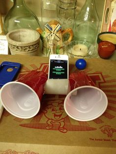 Use toilet paper roll and solo cups to amplify iPhone speakers.