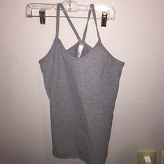 Grey exercise top Barely worn gray athletic top (not lulu lemon) very nice and from a nice brand called zen chi! lululemon athletica Tops Tank Tops