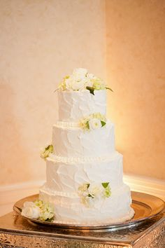 The Reception [cake]: texture | fresh flowers as topper | (overall presentation/design)