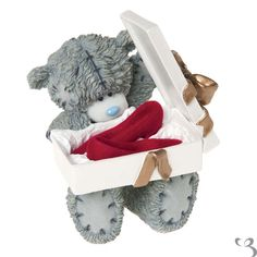 Me To You Figurine Put on Your Red Shoes This is a must have for all collectors of Me To You Tatty Teddy is sitting opening a shoe box inside shoe