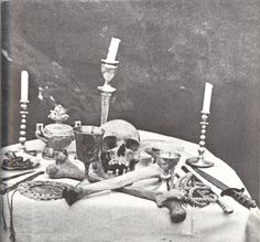 """Alex & Maxine Sanders, Winter Ritual, 1969.    """"Maxine Morris, high priestess of a Manchester coven sets the alter for a dawn ritual on one of the high and private ridges of the Yorkshire Moors.  Amongst the tools are their ritual swords - some handed down from past generations in witchcraft, human skull, bones and a symbolic broomstick."""""""
