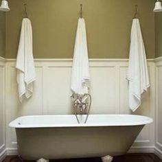 Wainscot in bathroom, claw foot tub.
