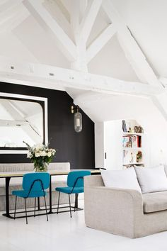 Love these blue chairs and love how they stand out from the black and white in the room