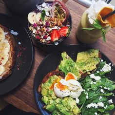 HEALTH IS WEALTH  Farmers Brekky: two soft boiled eggs smashed avo spinach and goats cheese on sourdough Acai bowl and Mango nana smoothie  | The Farm Wholefoods Potts Point |  @cocohealth #lickyourphone by lickyourphone