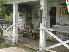 Chippy White...old farmhouse...porch with rockers & wicker...old basket...with crow.