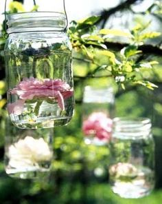 Got a lot of mason jars that you don't need? Guys, I've found so many creative ways to use them for your wedding decor! Mason jars are ideal as centerpieces – just add some water, flowers and stones on the bottom! Uses For Mason Jars, Pot Mason Diy, Hanging Mason Jars, Blue Mason Jars, Mason Jars For Weddings, Hanging Candles, Diy Hanging, Diy Wedding, Wedding Flowers