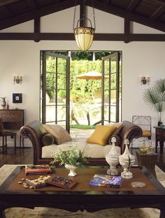colonial style, I already have the darkwood furniture, green plants....I need to paint my walls white