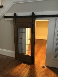 Nice sliding door for under stairs dog room instead of a crate!