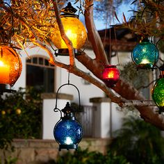 Pier 1's colorful handblown Medallion Glass Lanterns with embossed floral patterns make any outdoor gathering more festive.