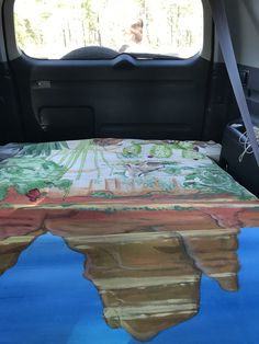 View of my Sedona Sleeper painted mattress in my RAV4 from driver's seat.
