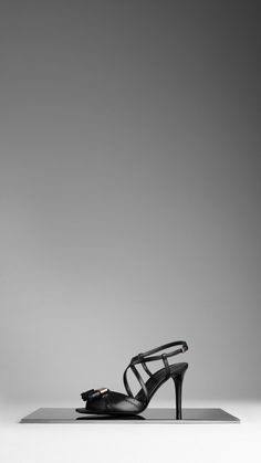 BURBERRY BROGUE LEATHER TASSEL SANDALS