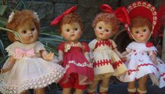 Four 1952 caracul (poodle) wigged Ginny dolls.  Three of them are in their Vogue Ginny clothes.