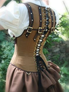 Your typical run-of-the-mill underbust corset does a good job of correcting lumbar posture (making you stand tall from your lower back), but some individuals still find that they slouch from the sh…