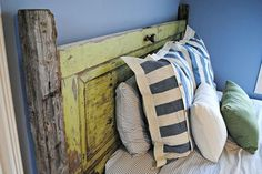 vintage door headboard, doors, repurposing upcycling, I love that the fenceposts are original to our farm They were here long before we were and now they re getting a new life instead of going to the trash pile