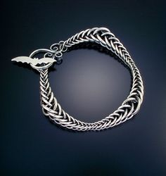 Ribbon Wave Bracelet by Julia Lowther. I think Momma and I would both want this...@Tamara Svoboda