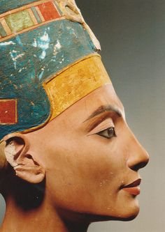 Egyptian bust of Queen Nefertiti - (Neues Museum, Berlin) - The Nefertiti Bust is a 3,300-year-old painted limestone bust of Nefertiti, the Great Royal Wife of the Egyptian Pharaoh Akhenaten, and one of the most copied works of ancient Egypt. Owing to the work, Nefertiti has become one of the most famous women of the ancient world, and an icon of feminine beauty. The work is believed to have been crafted in 1345 BC by the sculptor Thutmose. http://en.wikipedia.org/wiki/Nefertiti_Bust