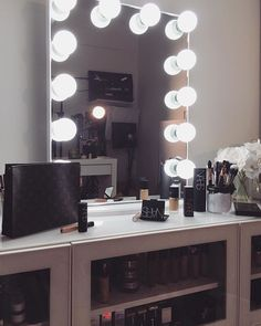 "Mirror from Storage unit from ikea. It's actually an entertainment center that I customized to store my makeup"" (DIY Vanity Ideas via: Desi Perkins) Vanity Set Up, Vanity Room, Vanity Ideas, Vanity Decor, Diy Vanity, Makeup Dresser, Makeup Vanities, Elegant Makeup, Glam Makeup"