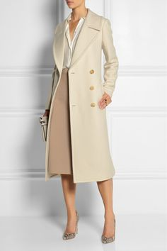 MICHAEL KORS Double-breasted wool-felt coat $2,795 EDITORS' NOTES & DETAILS Masculine cuts remain a key silhouette for Fall '14 and we love this tailored cream coat by Michael Kors. It's made from thick wool that's been felted for a smooth texture and is finished with horn-effect buttons. Wear this runway style with a pencil skirt and heels.