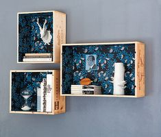 Love the wood boxes covered with wallpaper inside.