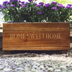 18 x 9 stained rustic wood planter box laser engraved with a large single initial, name or short phrase is made of lightweight fir wood and includes a galvanized metal insert