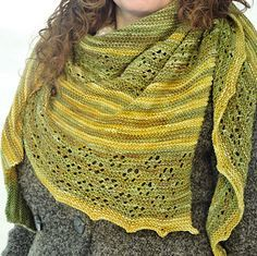 """DEEP FOREST"" is an asymetric triangle-shaped shawl knited with two colors in a combination of old Shetland Lace pattern so called Cat's Paw and garter stitch pannels."