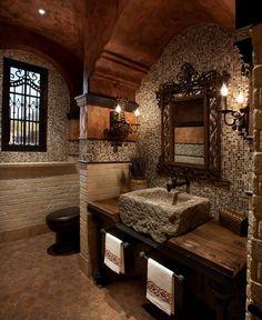 En esta imagen podemos ver un ejemplo de lavabo construido en piedra y estantería en madera Bathroom Design Inspiration, Tuscan Style