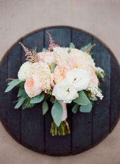 romantic wedding bouquet - photo by Shane and Lauren Photography http://ruffledblog.com/romantic-temecula-wedding-with-vintage-books
