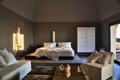 Gorgeous bedroom in a stylish hotel (see more) #island #italy #hotel #design #decor #inspiration #architecture #dark #tones #paint #wall #bed #big