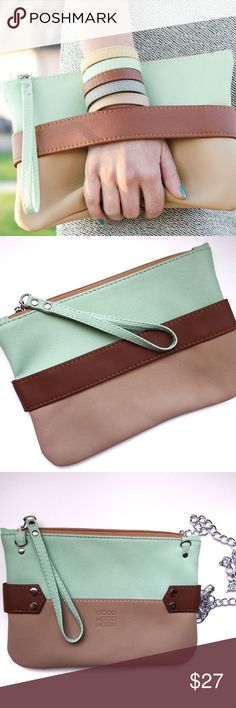 Never worn! Beautiful handmade vegan leather purse This bag is super cute! Handcrafted mint and tan vegan leather clutch. Has a great silver chain if you would like to wear it over the shoulder. Perfect condition. Comes with a dust bag. Bags Clutches & Wristlets