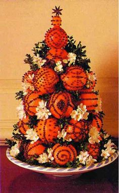 Clementines studded with cloves and topped with a kumquat and an anise star - a beautiful, long-lasting and fragrant sideboard arrangement for the holidays - optional, tuck in fresh cut boxwood greens and some berries or flowers.