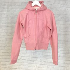 Pink Lululemon zip-up sweater Small white spot located below the right pocket. Otherwise in good condition lululemon athletica Sweaters