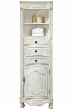 """22""""w Corner Linen Storage Cabinet, CORNER, IVORY by Home Decorators Collection. $339.00. 67.5""""H x 22""""W x 14""""D.. Fully assembled.. Add the elegant style of an antique to your bathroom while providing more space for your washcloths and towels with the Corner Linen Cabinet. This design allows you to take advantage of unused corner space, and the durable wood and wood veneer materials ensure long-lasting use. Order a bathroom cabinet today and add timeless elegance to y..."""
