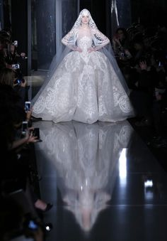 A model wears the wedding gown by Lebanese fashion designer Elie Saab for his Spring Summer 2013 Haute Couture fashion collection, presented in Paris, Wednesday, Jan.23, 2013. (AP Photo/Christophe Ena) | AP/Christophe Ena