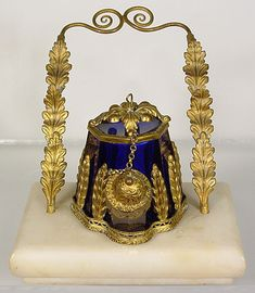 Teakettle Ink With Stand - white stone base, fancy metal pen holder, very ornate metal leaf decorative on the blue glass inkwell.  Base measures 2-5/8 x 3-3/4