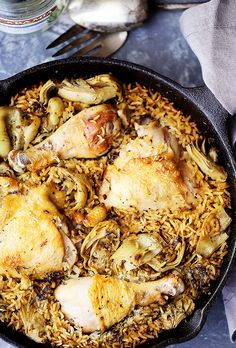 One Pot Chicken and Rice with Artichokes - Classic, delicious comfort food with chicken and rice made in just one pot! It's quick and easy, and the artichokes add so much flavor!