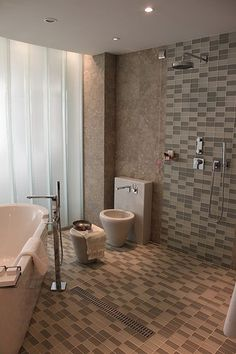 KCK bathroom remodeling ideas: Tile Craze is Still the Rage - If you loved last year's tile craze, you are in luck. Tiles are still all the rage, and they don't seem to be going anywhere. As a backsplash, flooring option, and shower enclosure, multi-colored tiles are a great way to add texture to an otherwise plain bathroom.
