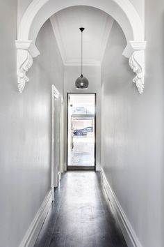 Combining glorious original features with modern architectural nous, this family home on Cunningham Street in Northcote will have you swooning. Victorian House Interiors, Victorian Homes, Victorian Terrace, 1920s House, Edwardian House, Interior Decorating Styles, Hallway Decorating, Narrow Entry Hallway, Weatherboard House