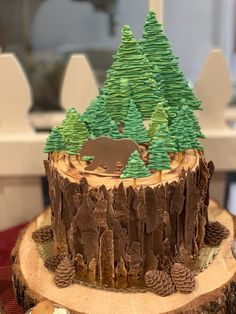 Pine Tree Round Cake Bear inspired chocolate peanut butter pine tree round cake, adorned with chocolate bark, edible pine cones, Bear and pine trees! Christmas Desserts, Christmas Treats, Christmas Baking, Christmas Tree Cake, Pretty Cakes, Beautiful Cakes, Amazing Cakes, Crazy Cakes, Fancy Cakes
